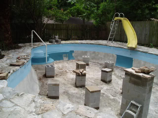 convert the swimming pool to a koi pond with side view and