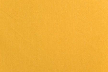Tkanina typu bawełna w miodowym kolorze