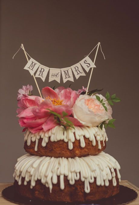 Brides.com: . A naked bundt wedding cake, topped with fresh florals and a light drizzle of frosting, by Nothing Bundt Cakes.