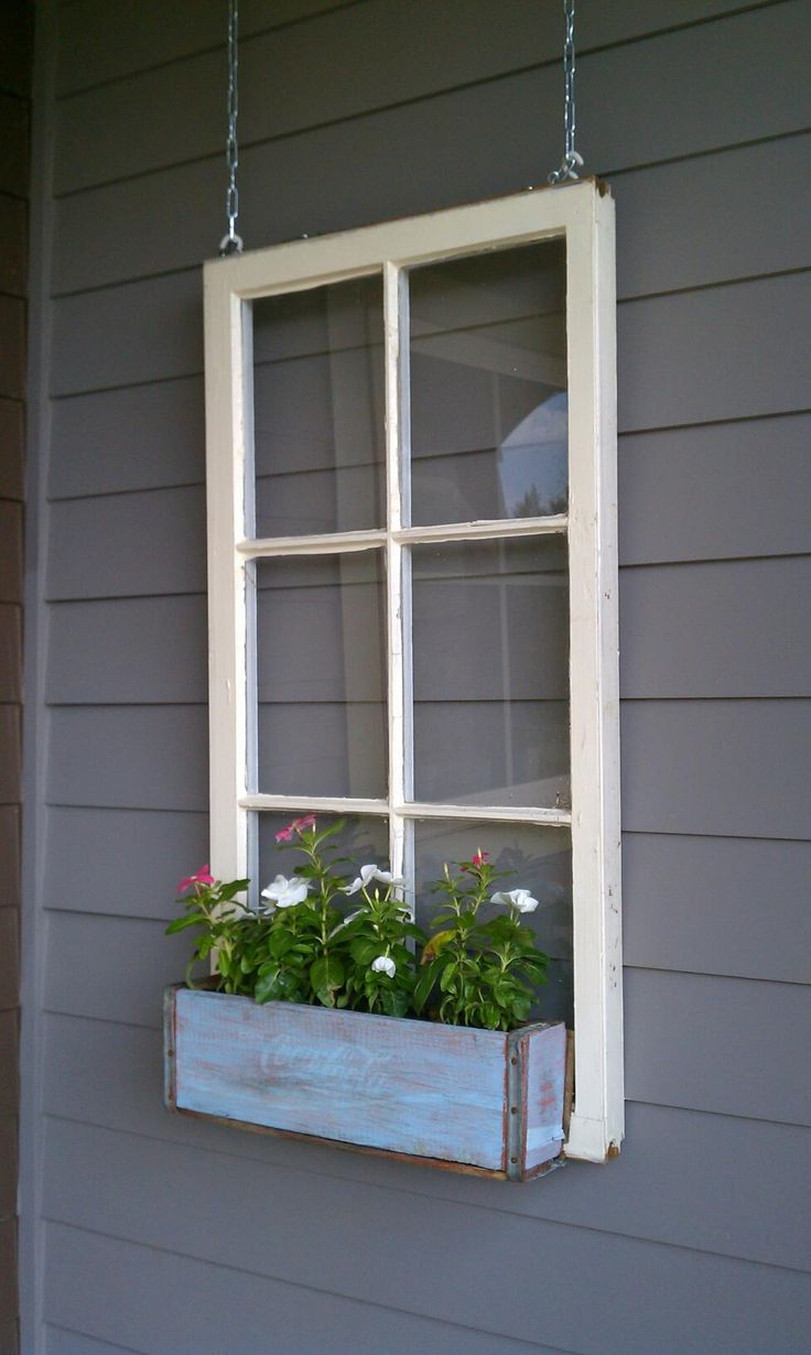 Getting an old window without glass. Then I'm going to hang it on the privacy fence and put flowers along with a trailing vines up and down.