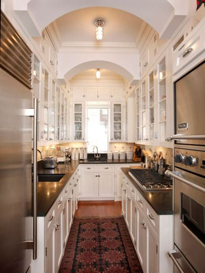 This galley kitchen is so gorgeous. I wouldn't mind a small space if it looked like this.