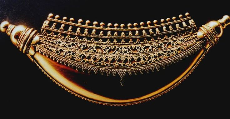 """Crescent-shaped gold pendant called """"kokke thathi"""" from Coorg, a region within the Nilgiri Hills of Tamil Nadu (a great region for jewelry!). A traditional ornament of the region: the most precious marriage present of the future married wife. While symbolising elements of nature, the crescent reflects the Muslim infuence in the region of Coorg. The length is 12.3 cm, and it appears to be 20th c. See pp. 148-9 of *Inde: Bijoux en or des collections Barbier-Mueller* (2004)."""