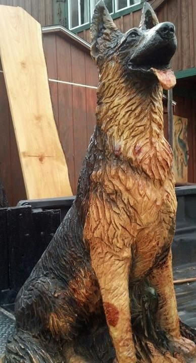 German shepherd chainsaw carved by jeff pinney i ve