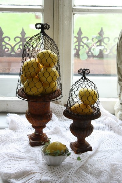 chicken wire~over the urns you already have!