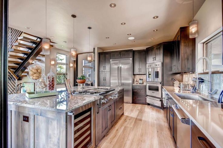 This sleek contemporary kitchen was completed by Double Diamond Property & Construction Services. #luxeCO