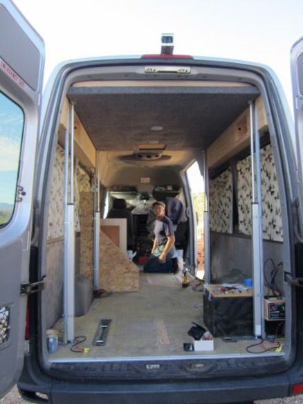 Bed Lift In A Sprinter With Linear Actuators To Put An Eating Area Below For Cold Wet Days