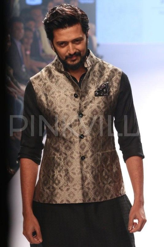Riteish Deshmukh walks the ramp for Raghavendra Rathore at LFW : Made in India – Looking dapper in the Indian attire, actor Riteish Deshmukh walked the ramp for designer Raghavendra Rathore for his Lakme Fashion Week Summer Resort 2015 Collection, on Thursday. Riteish was seen sporting a black and white kurta pyjama. The detailing on his nehru jacket was quite intricate and... #madeinindia
