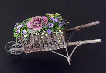 PepperWood Miniatures in a wicker wheelbarrow by Uncle Ciggie's