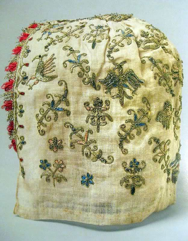 Linen cap with silk and metal embroidery and glass beads, Venetian ca. 1500-1525 (The Met, New York) Woman's Cap, Venice, 1500–1525, linen, silk, metal thread, glass beads, 9 x 7 3/4 in. The Metropolitan Museum of Art, New York, Rogers Fund, 1916. Color image shared by Louise Pass on Facebook Historic Hand Embroidery group. Retrieved September 25, 2011 from the http://www.facebook.com/photo.php?fbid=2159223897493set=o.156337781110182type=3theater From Kimiko Small