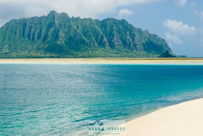 Kaneohe Bay Oahu - I have kayaked out to the sandbar and swam and snorkeled from a pontoon boat. Magical! Can you see Chinaman's Hat to the right at the base of the mountains? The panorama of beauty sitting on in a kayak out in the bay and looking back at the shore ... soul-stirring. I swam with Honu here :)