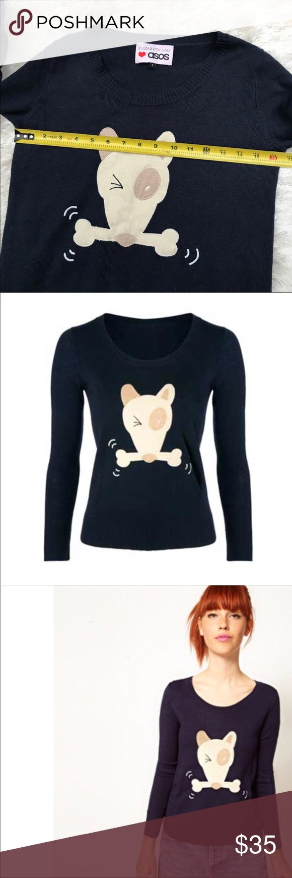 """ASOS Elizabeth Lau Dog & Bone Sweater Elizabeth Lau for ASOS """"Dog & Bone"""" Sweater ($131.93 at US.ASOS.com) features an adorable illustration of a Spud McKenzie-ish bull terrier clutching a bone with its teeth, but what makes the design particularly funny is that, in Cockney rhyming slang, the expression """"dog and bone"""" means """"phone,"""" as in """"get on the dog and bone.""""   Approx. bust is 16.5. ASOS Sweaters Crew & Scoop Necks"""