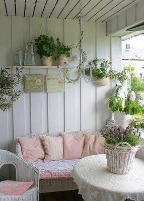 Cottage porch...want to do this if we ever move except with lavender and different shades of yellow in the pillows and cushions and maybe paint walls a very light seafoam green with white trim... Maybe?