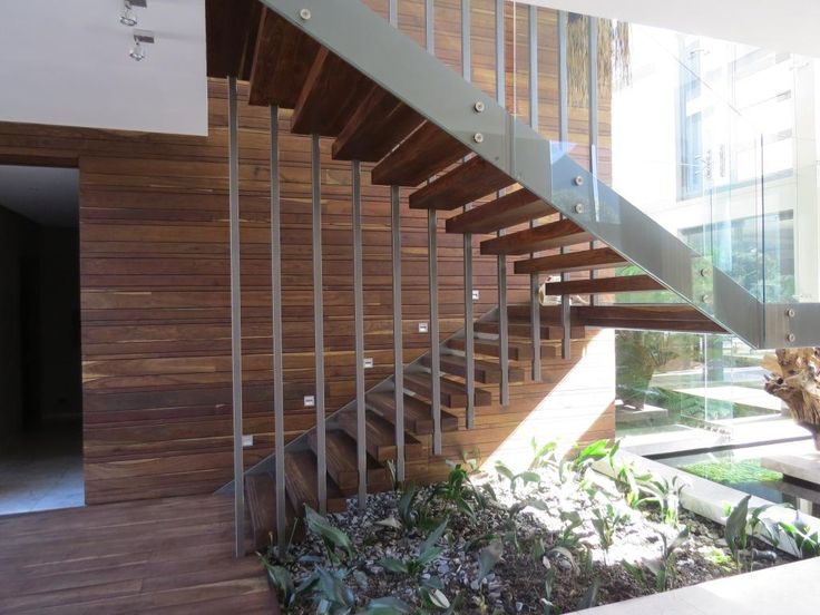 Staircase. Thai Contemporary fusion home, Cape Town, South Africa. By RennieScurrAdendorff Architects