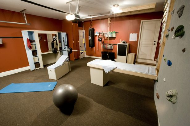 Extraordinary Garage Makeovers: Home Gym Garage, After: In just three days, Garage Mahal turns a cramped and cluttered garage into a space that serves double duty for parking cars and working out. The new gym offers a variety of fitness essentials. From DIYnetwork.com