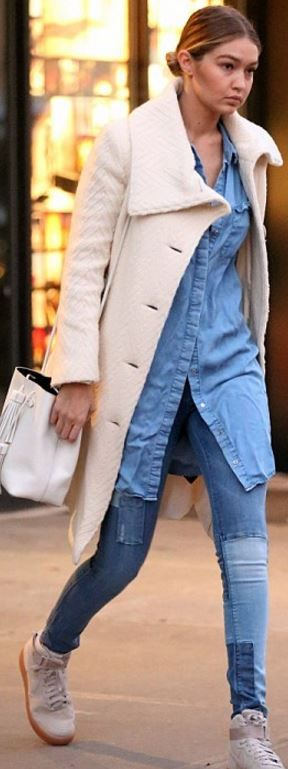 Who made  Gigi Hadid's suede sneakers, blue skinny patch work jeans, and white bucket bag?