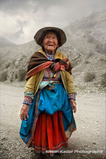 Old Andean Lady wearing traditional Colca clothing, intricately embroidered and brightly colored skirts, vest and hat.  Chivay, Arequipa, Peru  #world #cultures