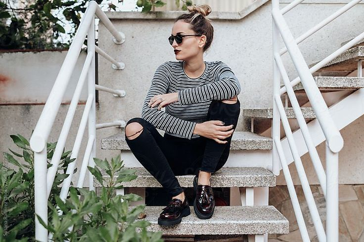 Fashion woman sitting on the stairs by Susana Ramírez for Stocksy United