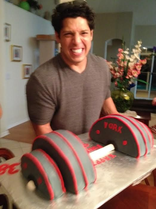 weight lifting cake, easy. looks like four round cakes cut in half and something molded for the bar!!