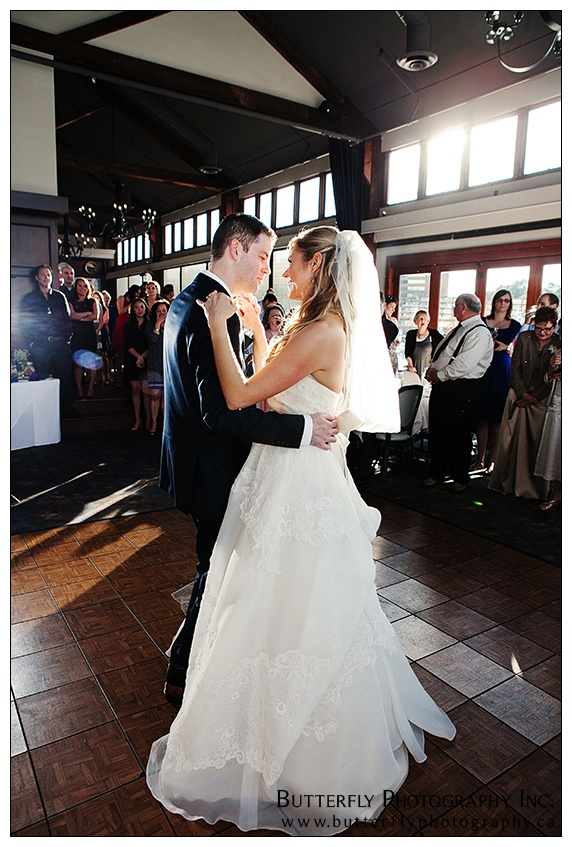 First dance photo of couple at Bridges Restaurant by Vancouver wedding photographer www.butterflyphotography.ca