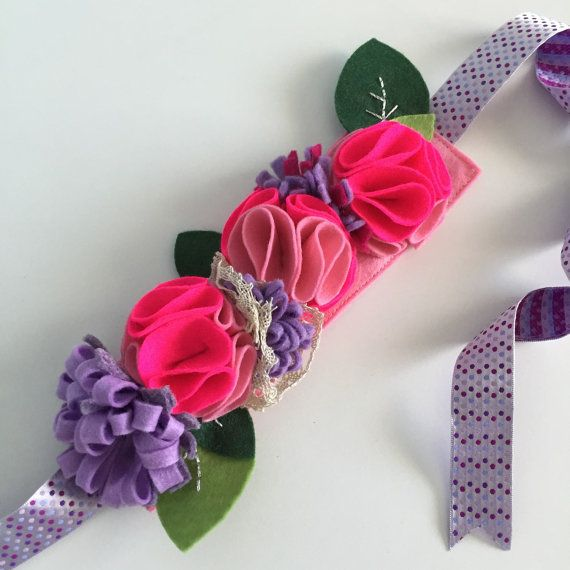 Our flower headbands are 100%handmade. Each flower has been carefully hand cut and sewn using sturdy thread . Everything is made of wool blend, striking colours felt. Some flowers inside hold a little bead or jewel. Each headband has a ribbon to tie around your head.  Great to be worn on special occasions, or everyday. Wear it on your hair or a hat.     Please do not wash .     All wreaths are made with parts that can become potentially hazardous. Please do not insert wreaths/headbands into…