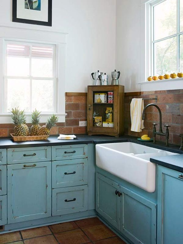 Charming cottage kitchen with salvaged brick backsplash and blue cabinets