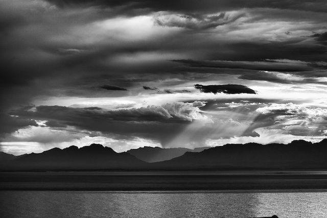 Beautiful light streams in through morning clouds across False Bay, Cape Town