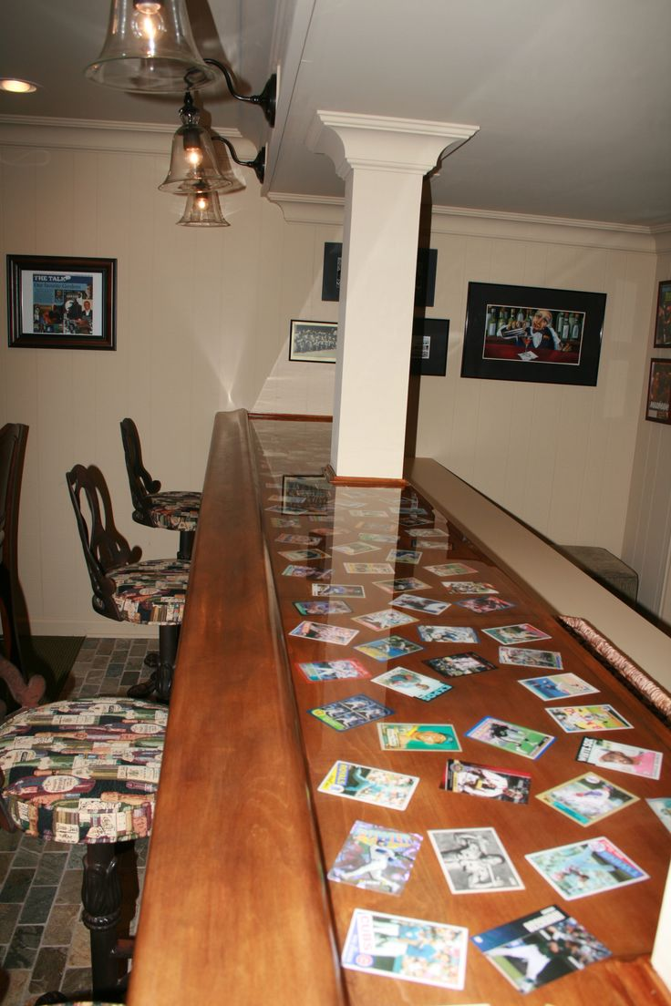 Old baseball cards incorporated into the bar top. by Thomas Homes, Inc.
