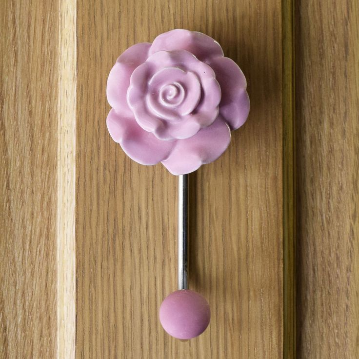 Pink coloured ceramic flower with chromed metal hook  Update your hall way and reception rooms with these glorious ceramic flower coat hooks  These beautiful coat hooks can instantly transform your home.  Made from painted ceramic with chrome metal hook