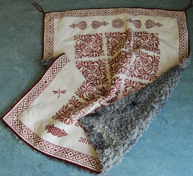 A Norwegian tradition is the use of sheepskin. This baby coverlet are with printed pattern on one side