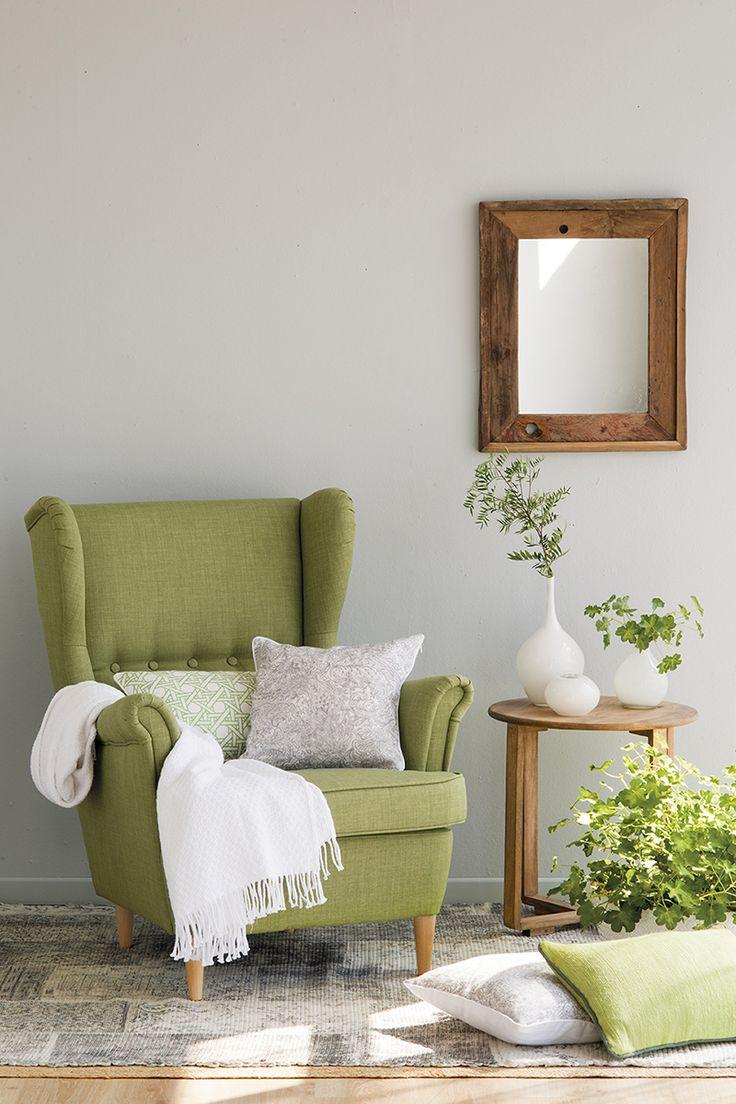00451369. Zona de estar con paredes y alfombra grises y una butaca en verde_00451369