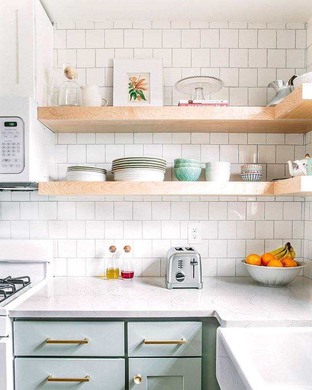 Kitchen With Subway Tile, Mint Green Cabinets, And Open Shelving.