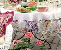 Vintage hankies used as edging on a tablecloth. How pretty! Same concept, but how about made into a valance for the kitchen window?