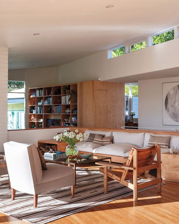 A+built-in+combination+planter/sofa/end+tables/stairway+anchors+the+living+room,+above.+The+plywood+wasn't+treated+with+a+UV+filter;+the+couple+wanted+it+to+age+naturally+in+the+sunlight.