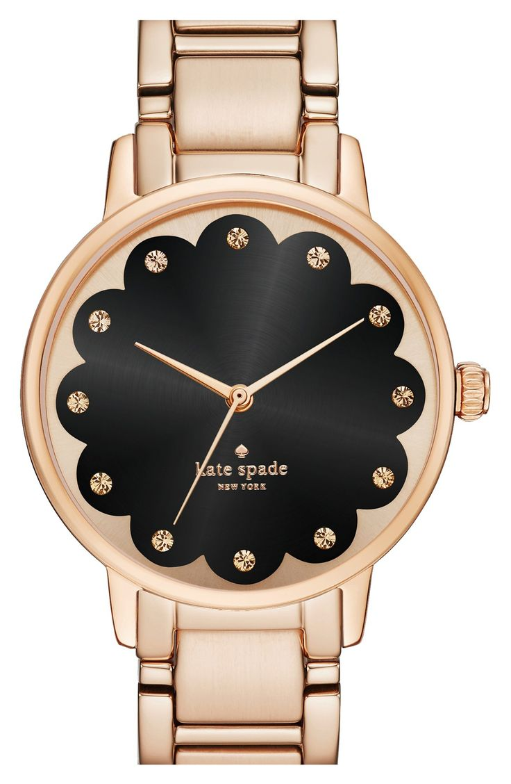 Obsessed with the rose gold + black combination on this round watch from Kate Spade. The scalloped face makes it all the more chic!