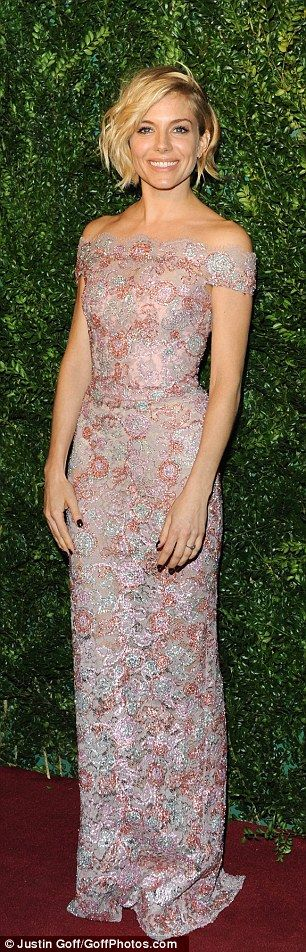 Metallic marvel: Actress Sienna Miller looked incredible in a floor-length lace gown which she teamed with silver platforms