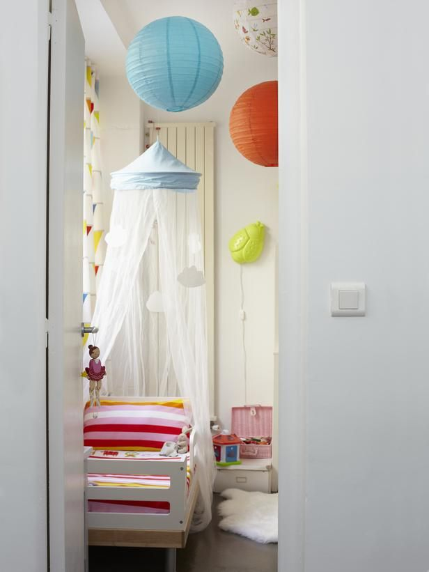 "Make a ""big-kid"" bed feel even more special with a dreamy canopy overhang. When your child outgrows the toddler bed, you can keep the canopy in place to drape over the next frame, or simply remove it from the ceiling. Photo courtesy of live from IKEA FAMILYCanopies Over Beds, Beds Canopies, Paper Lanterns, Ikea Kids Room, Room Ideas, Kid Rooms, Flags Garlands, Child Bedrooms, Toddlers Bedrooms"