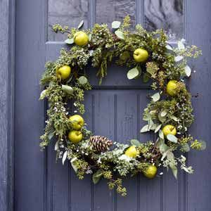 Mixed Greens Wreath: This woodsy design, studded with fruit and plants, blends faux and real. #christmas #holiday #wreath