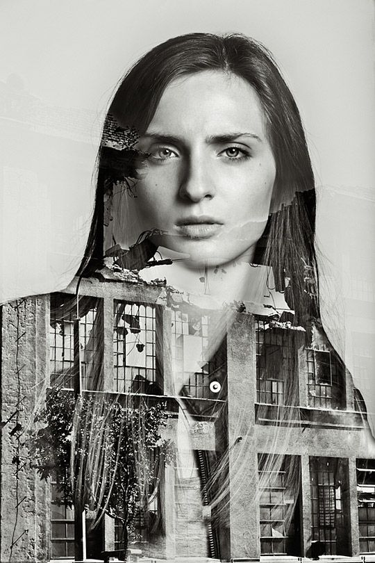 Building under demolition as the background. The female model is wearing a leather jacket. Her face is placed in the space where the building is demolished.