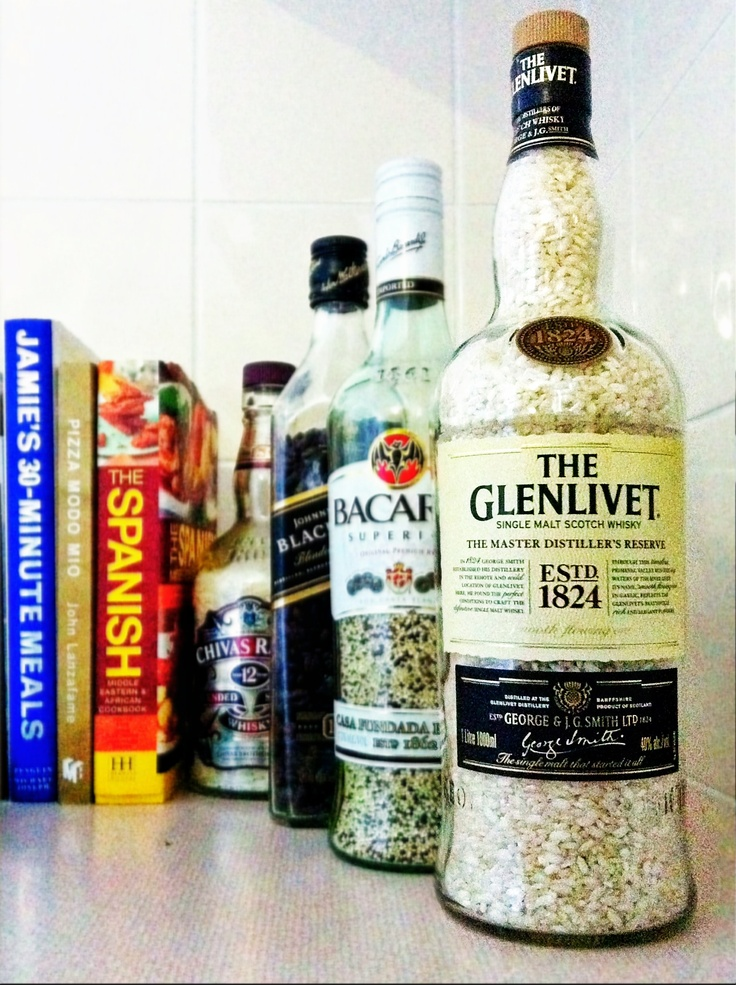Empty liquor bottles to store open packets of rice, quinoa, coffee beans etc. Better for pantry shelves than short, wide jars.