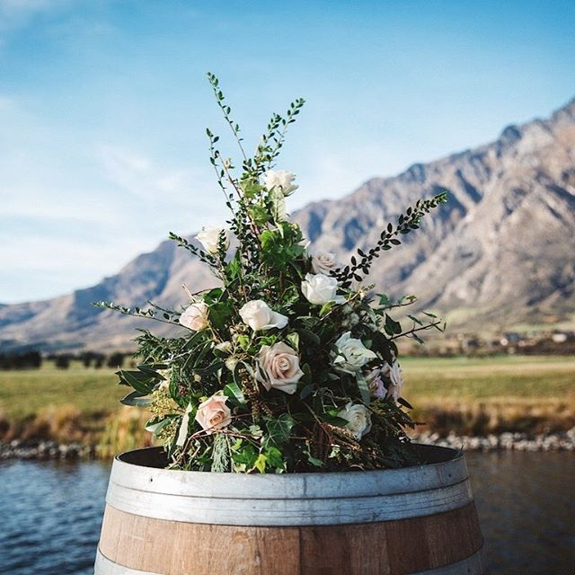 """Wine barrels can be a gorgeous platform to accent your """"I dos"""""""