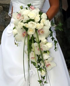 Cascading bouquets are perfect way to elevate the dramatic appeal of your bridal look. Created by Mission Viejo Florist #Mission Viejo #California