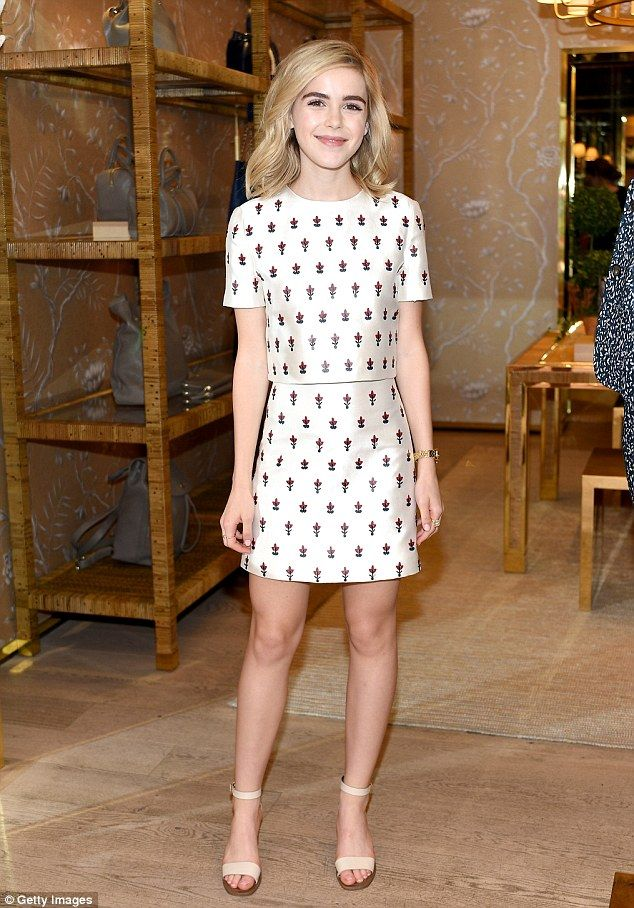There she is! Kiernan Shipka hit a fashion high note in her off-white two piece print outf...