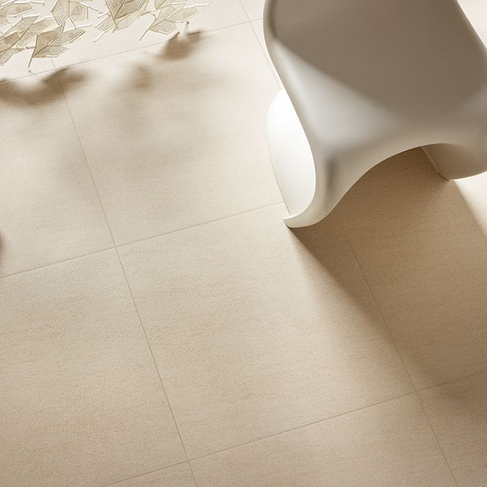Warm beige floor tiles are the perfect backdrop to any furniture. Shown here: Quattro Beige