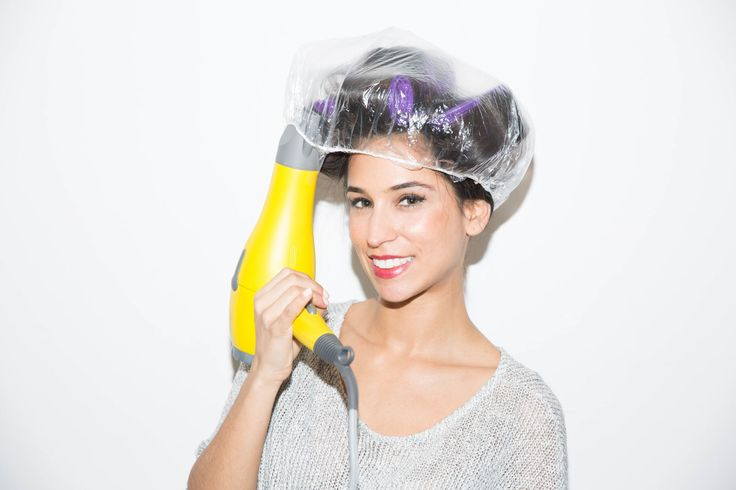 Mimic the effects of a hot roller set with velcro rollers, a shower cap, and a hair dryer.