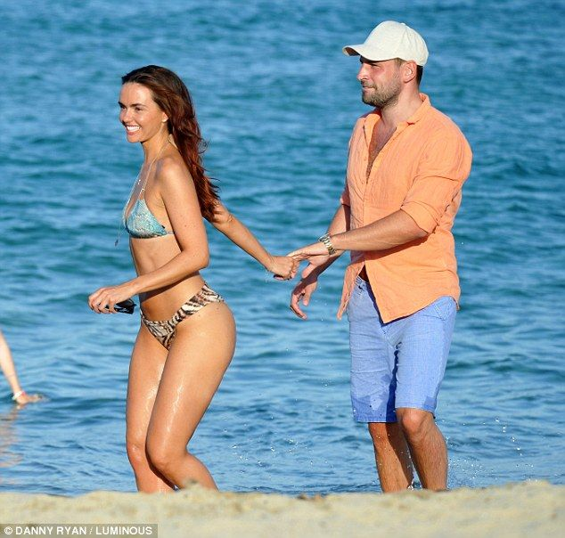 Romantic getaway: Jennifer led the way as she grabbed her beau's hand for a trek up the sa...