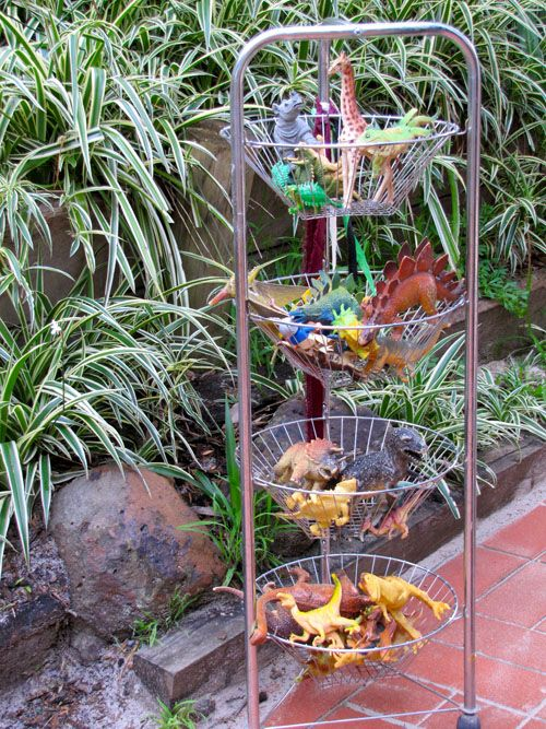 """Old multi-tiered wire fruit & vegetable basket used to store animals near the outdoor sandpit ("""",)"""