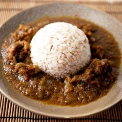 A southwestern Nigerian dish made with locally grown rice and a sweet hot pepper stew.