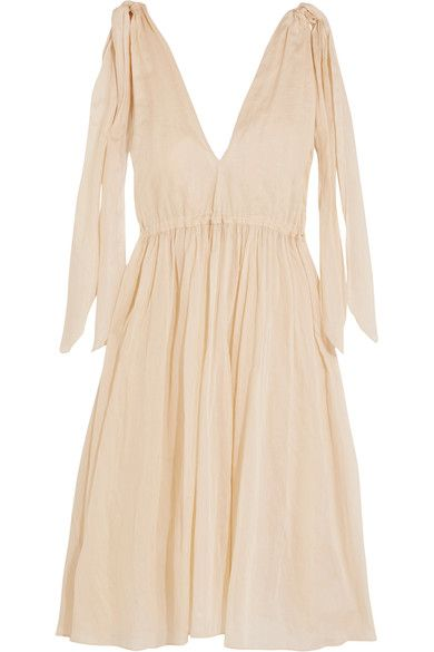 This cream 'Nikiya' dress by Three Graces London is crafted from semi-sheer cotton-mousseline that's perfect on balmy days. Cinched below the bust to create flattering definition, this loose-fitting style has adjustable tie-fastening shoulders. Complete your look with a straw tote and sandals.