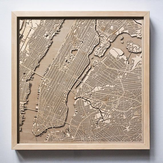 CityWood is a high-quality minimalist wooden map for map lovers, created with a laser-cut precision.  New York Wooden Map  CityWood is a wooden map artwork. City streets, water and landscape are represented by separate wooden layers. Each layer of high-quality plywood is laser cut