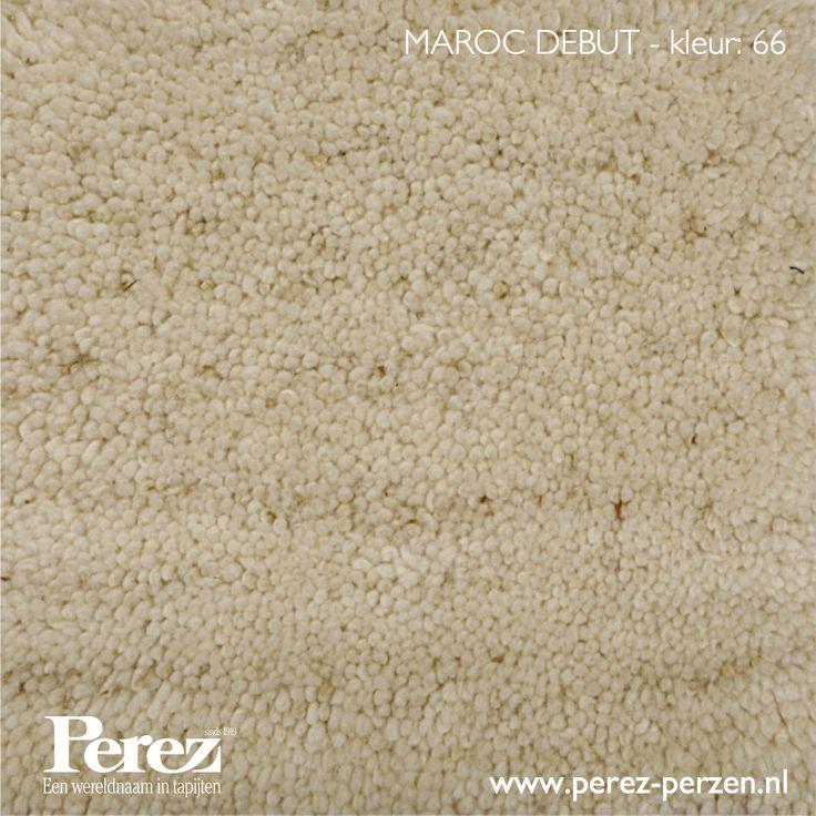 Marokkaans berber tapijt. Handgeknoopt en poolgarens van 100% wol. Ecru van kleur en een subtiele mellering. Uit voorraad leverbaar in 14 afmetingen tot en met 400 x 300 cm.